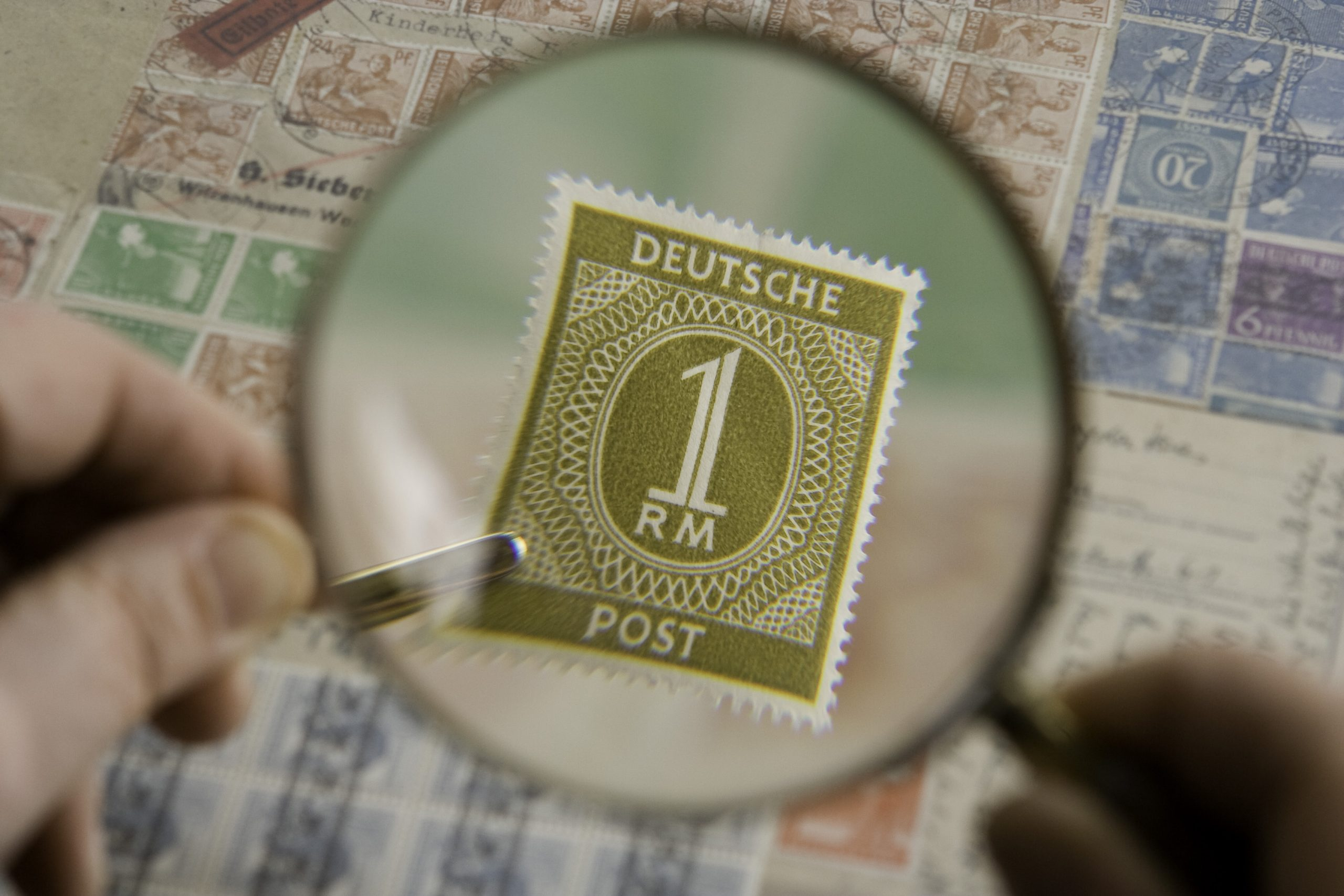 Magnification Of Stamp With The Help Of Magnifying Glass